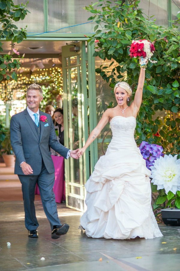 bride and groom entrance to alice in wonderland themed reception at la caille in utah- photo by heather nan