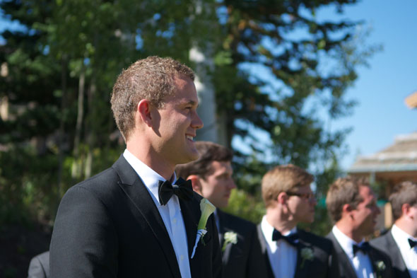 grooms first look during park city utah summer wedding- photo by dezember