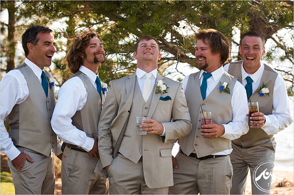 groom and groomsmen in khaki suits and blue ties for beach wedding