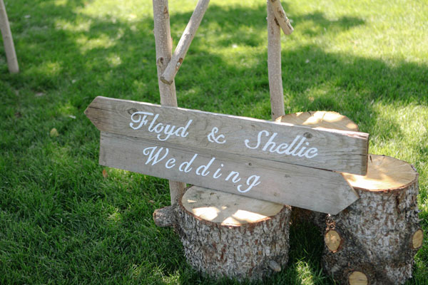 planked wood wedding sign for rustic wedding in utah- photo by jacque lynn