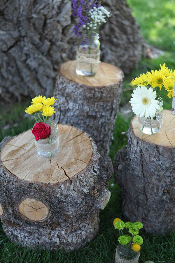 wildflower tree stump for rustic wedding- photo by jacque lynn